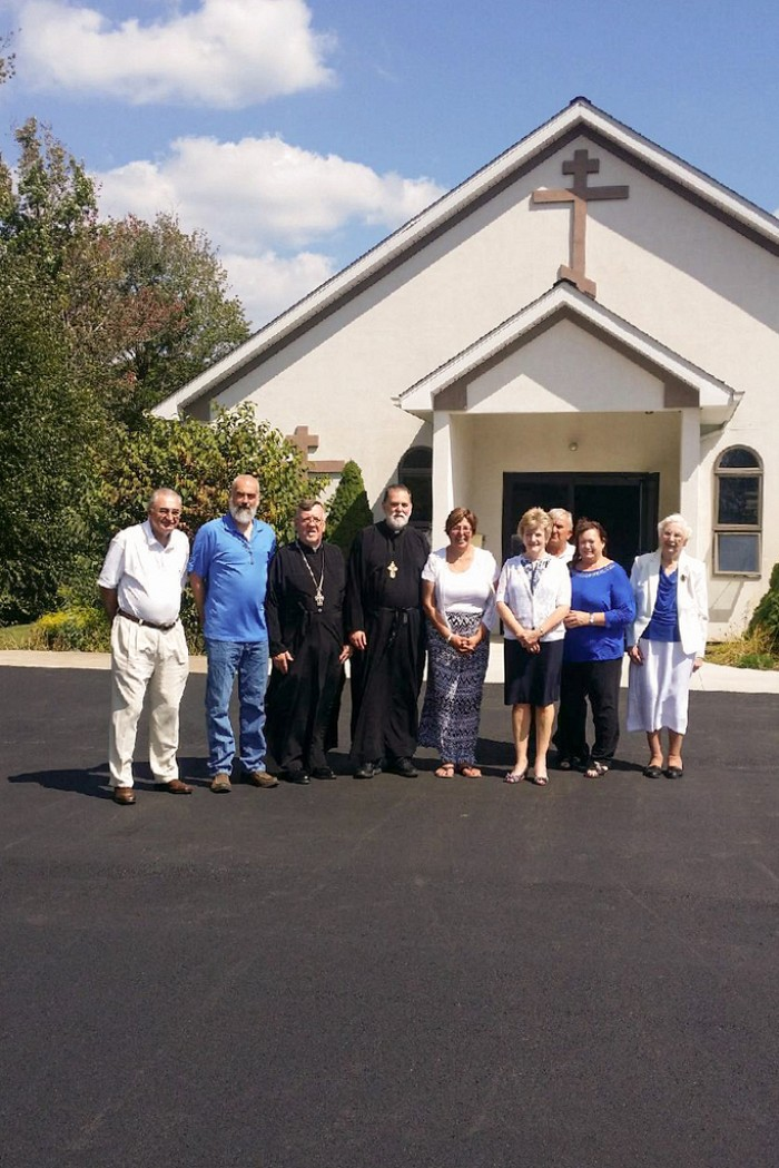 Fr. John Kowalczyk Parish Administrator and Fr. John Nightingale along with St. Basil's Parish Council standing on their newly paved parking lot.