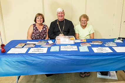 Claire Remington, Fr. James Weremedic, Gloria Bench were at the table